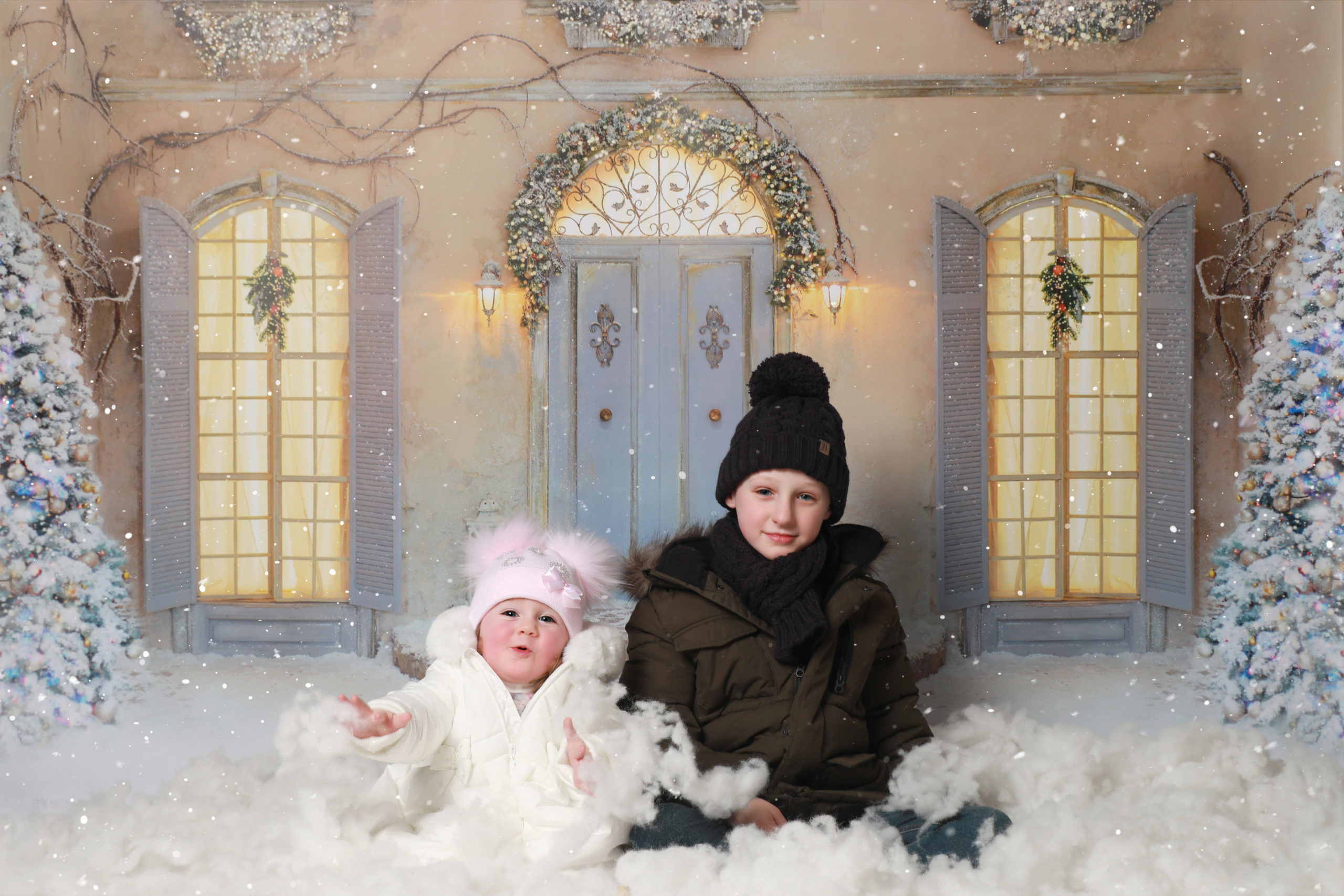 children playing in snow christmas theme