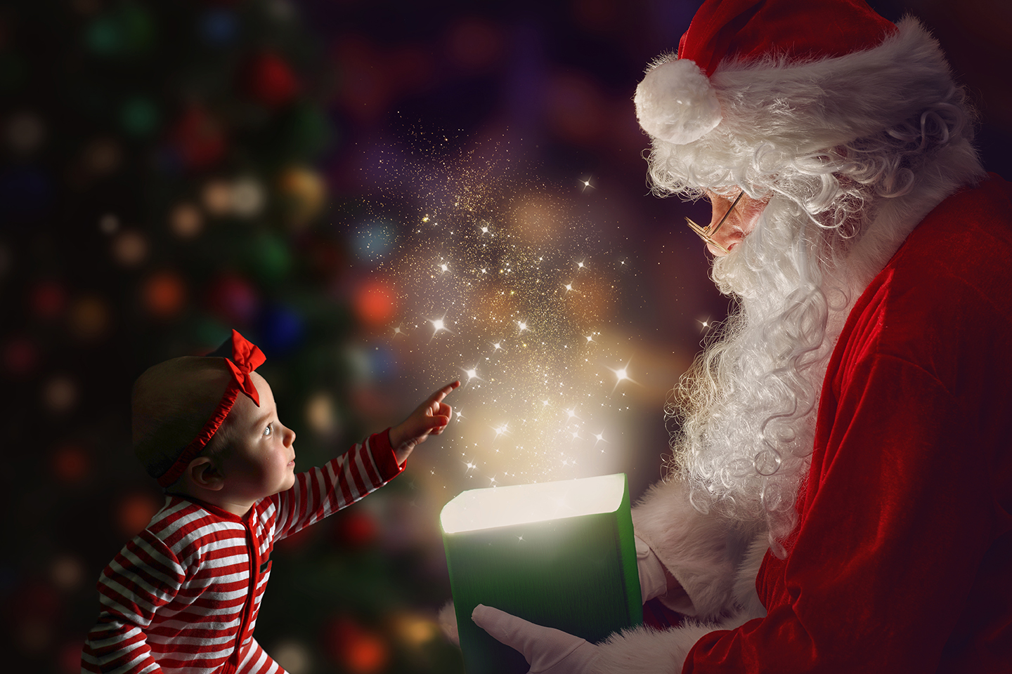 little girl in magical christmas background with santa holding a gift with magic light sparkle inside